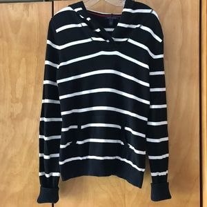 Black and white striped sweater with red patches